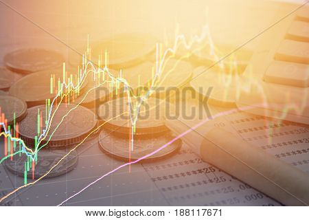 Business, finance, saving or investment background concept : Double exposure of stock exchange graph chart and coins, pen, calculator, saving account passbook