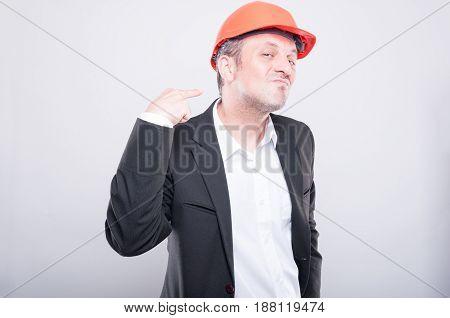 Upset Foreman Wearing Hardhat Making Cutting Neck Gesture