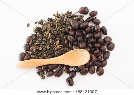 Coffee bean and tea leaves with wood spoon on white background