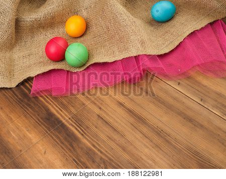 Easter colored egg. Mock up for your greetings card or design. Russian and Ukrainian, orthodox, slavic traditional Easter, rural background with burlap and colored mesh