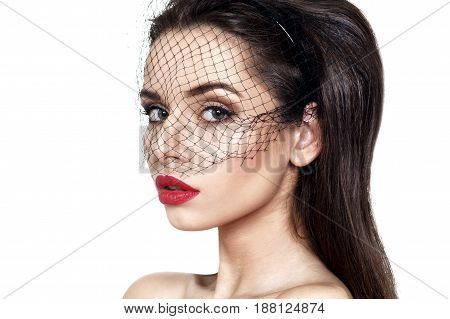 closeup fashion portrait of young beautiful woman wearing black veil isolated on white background