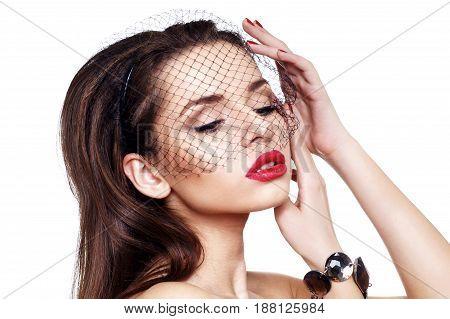 fashion studio closeup portrait of young beautiful elegant woman in black veil