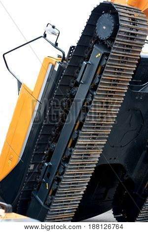 Excavator uplifted almost upright - Continuous track allows the vehicle to overcome the great unevenness of the terrain