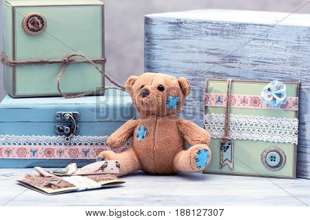 A soft bear on the table. Still life with a toy.