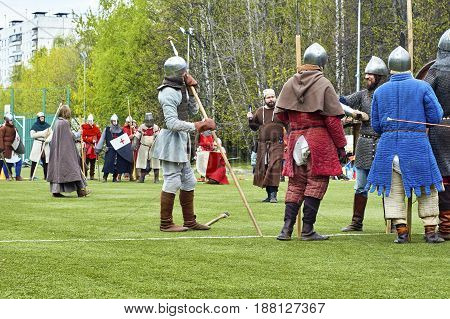 Moscow - May13 2017. Reconstruction of medieval battle between russian and european warriors on school football field