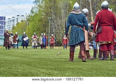 Moscow - May13 2017. Reconstruction of medieval battle between russian and european warriors on school foorball field