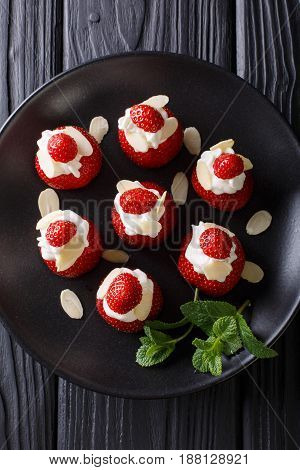 Fresh Strawberries With Almonds And Whipped Cream On A Plate Close-up. Vertical Top View