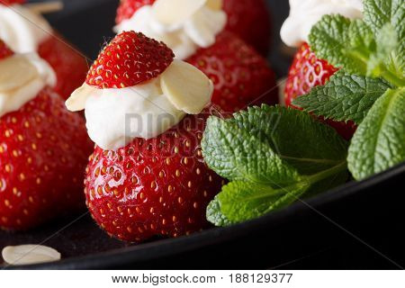 Delicious Food: Strawberries With Whipped Cream, Almonds And Mint Macro. Horizontal