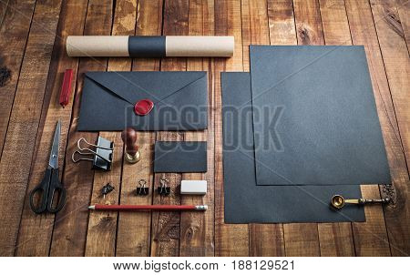 Blank black stationery set on vintage wooden table background.. Template for branding identity. For graphic designers presentations and portfolios.