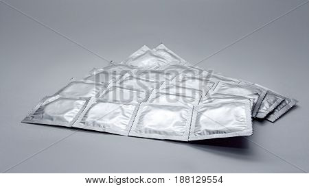 Condoms Pack On A Gray Background
