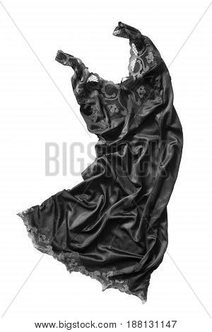 Crumpled black satin nightdress isolated over white