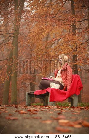 Blonde Girl Reading Book In Autumn Scenery