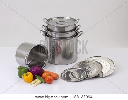 Set of stainless pots with lids and vegetable
