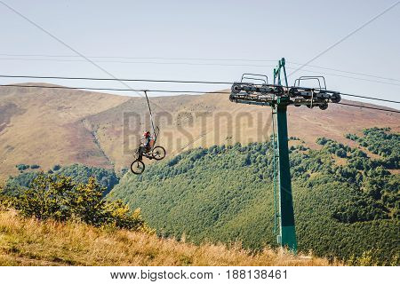 Mountain Biker Transport Bicycle By Cable Car Lift