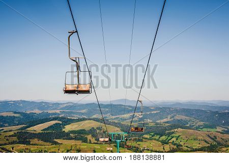 Ski Lift With Blue Sky And Mountains On The Background