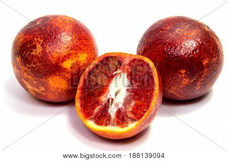 Half of bloody orange with leaf isolated on a white background