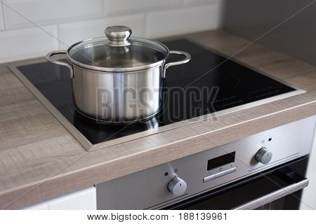 Pot On Stove In Modern Kitchen
