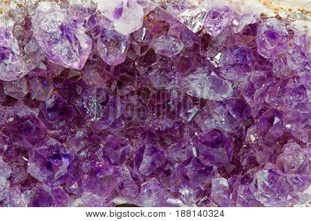 macro view of araw fragment of amethyst mineral gem stone