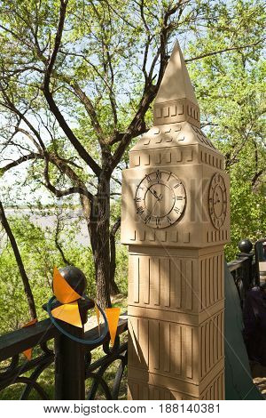 Khabarovsk Russia - May 20 2017: Cardboard scaled model of London attraction Big Ben. Miniature carton replica of a clock tower. Handmade craft symbol of England