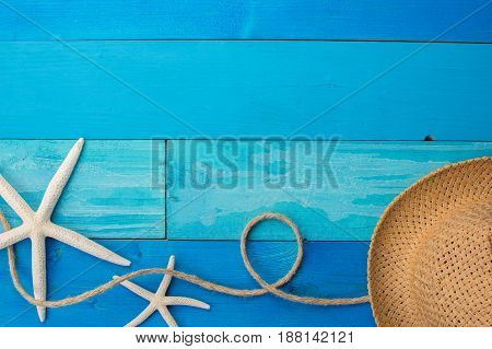 Beach accessories on wooden board with place for your text. Top view.