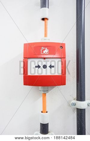 On the wall in a building there is a fire detection