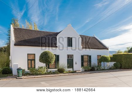 MONTAGU SOUTH AFRICA - MARCH 26 2017: An historic house with thatch roof in Montagu a town in the Western Cape Province