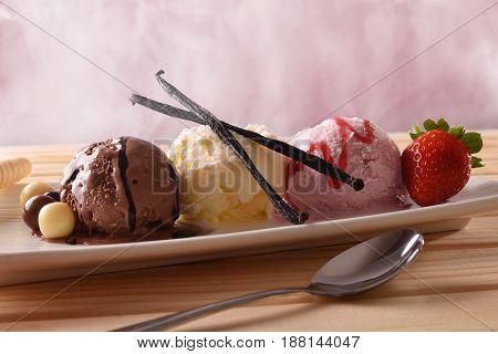 Three Balls Ice Cream Different Tastes On Wood Table Front