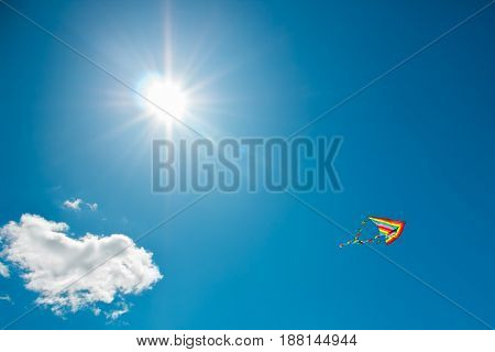Kite flying against the background of clouds