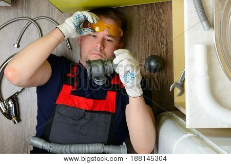Plumber In The Kitchen Can Not Do Plumbing: Top View