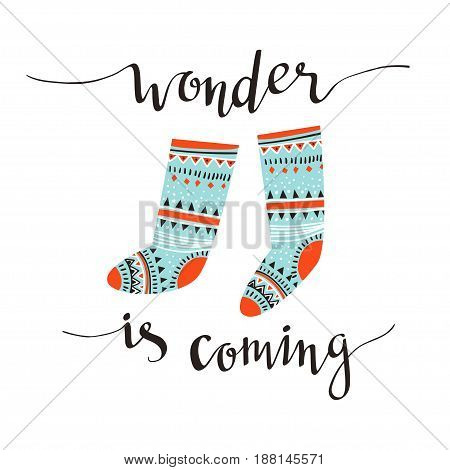 Hand-written Christmas lettering and christmas socks for gifts isolated on white background. Season vector holiday design with calligraphy - Wonder is coming.