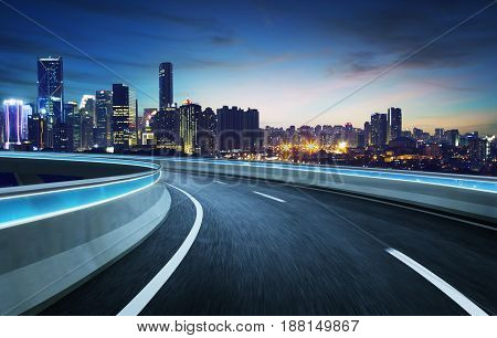 Moving forward motion blur flyover with city skyline night scene .