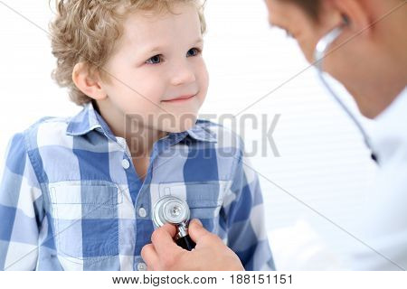 Doctor examining a child  patient by stethoscope.