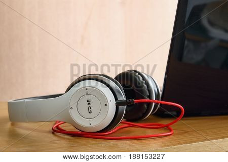 Headphones white put on a wooden background