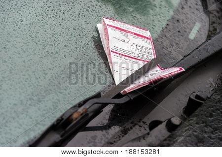 Montreal CA - 25 May 2017: A parking ticket on a car on Laurier Street