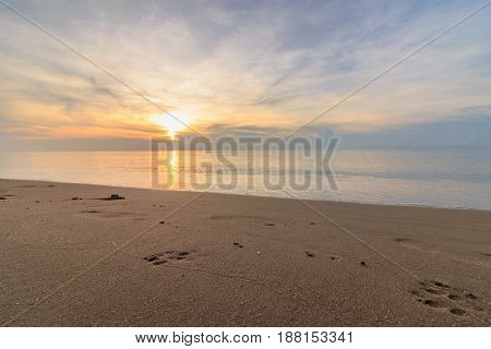 Beach sand with sunrise in morning as backdrop