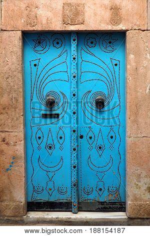 old blue doorway in north african city