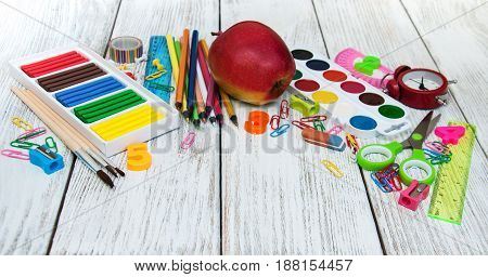 school office supplies on a old wooden table