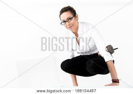 Portrait of woman demonstrating gladness while doing exercise. She looking at camera. Copy space