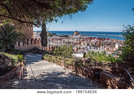Medieval moorish fortress Alcazaba in Almeria Access to the fortress with gardens and trees of different species panoramic view of the city take in Almeria Andalusia Spain