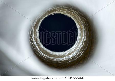 Inside A Skein Of White Thread