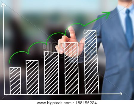 Sales Growth Graph - Businessman Hand Pressing Button On Touch Screen Interface.
