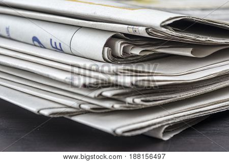 Close up shot of a pile of newspapers