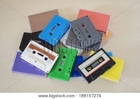 Retro colorful audio tapes and cases on the table