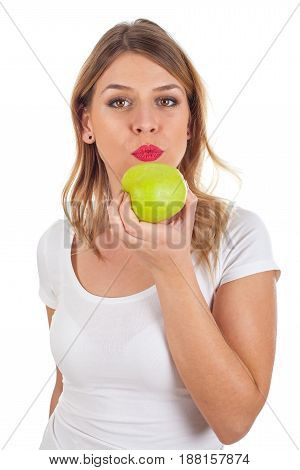 Picture of a young woman biting of a huge apple