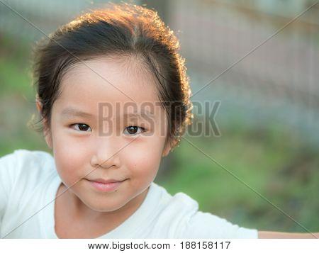 adorable Asian cute girl close up head shot healthy girl