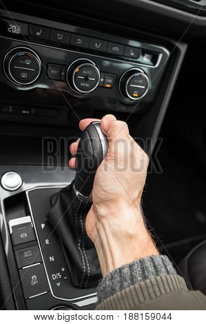 Drivers Hand Holds Gear Lever