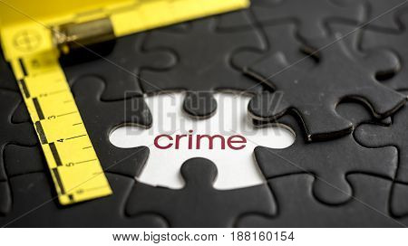 Word crime under jigsaw puzzle piece with bullet and csi marking on the side