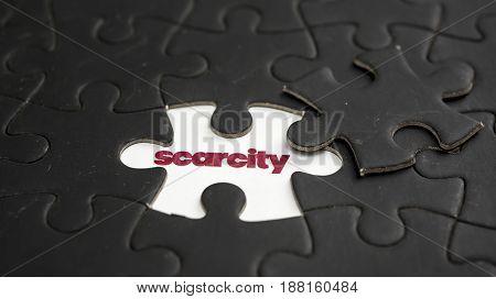 Word scarcity under black jigsaw puzzle piece
