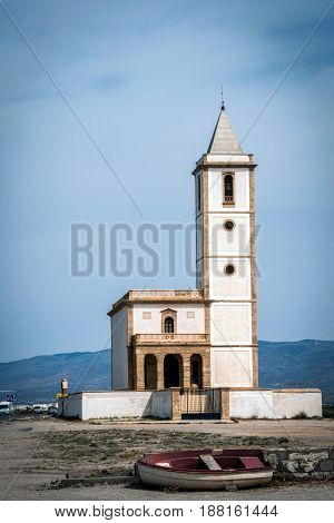San Miguel Beach And Salinas Church With Stranded Boats, Take In Cabo De Gata, Almeria, Andalusia, S