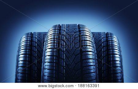 three tire profiles against a dark background